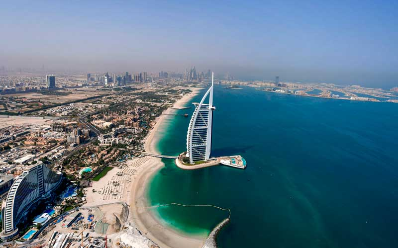Dubai : This picture taken on July 8, 2020 shows an aerial view of the Burj al-Arab hotel in the Gulf emirate of Dubai, during a government-organised helicopter tour. AFP PHOTO